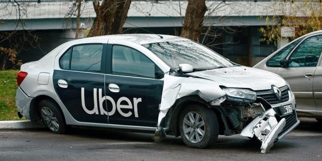 I am an Uber driver who was in an accident while driving a passenger